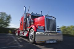 Red classic big rig semi truck with lot of chrome accessories wi stock photos