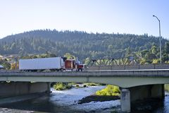Red classic big rig semi truck with refrigerated semi trailer tr stock photos