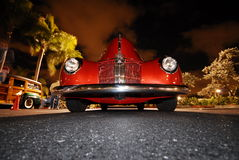 Red classic Car. Red oldie shiny classic car from a low angle stock photo