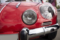 Red Classic Car. Front of a red classic car with headlight detail. Horizontal Composition Royalty Free Stock Photos