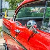 Red classic car. View of the side mirror of a collectable car at a classic car show Royalty Free Stock Photos