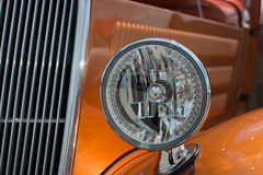 Red classic car. View of the side mirror of a collectable car at a classic car show Stock Photos