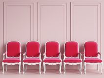 Red classic chairs are standing in an empty pink room with moldings on the wall Royalty Free Stock Photography