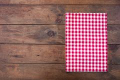 Red classic Checkered tablecloth on wooden rustic  table, backgr. Ound with copy space Royalty Free Stock Photography