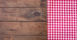 Red classic Checkered tablecloth on wooden rustic  table, backgr. Ound with copy space Stock Photo