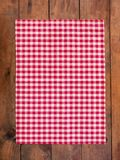 Red classic  Checkered tablecloth on wooden table, background wi. Th copy space Stock Photo