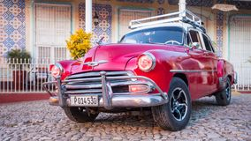 Red Classic Chevy is parked in front of a home. Trinidad, Cuba, Nov 28, 2017 - Red Classic 1950`s Chevrolet is parked in front of a home stock image