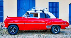 Red Classic Chevy is parked in front of a home. Trinidad, Cuba, Nov 28, 2017 - Red Classic 1950`s Chevrolet is parked in front of a home stock photo
