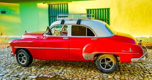 Red Classic Chevy is parked in front of a home. Trinidad, Cuba, Nov 28, 2017 - Red Classic 1950`s Chevrolet is parked in front of a home royalty free stock photos
