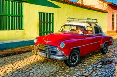 Red Classic Chevy is parked in front of a home. Trinidad, Cuba, Nov 28, 2017 - Red Classic 1950`s Chevrolet is parked in front of a home royalty free stock photography