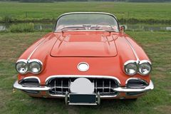 Red classic corvette. Classic corvette standing outside shot straight from the front stock photography