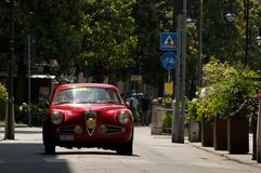 Classic Coupe` at Mille Miglia 2016. A red classic coupe` passing through Tasso street Bergamo, Italy before the crowd during the 2016 Mille Miglia classic car Royalty Free Stock Photography