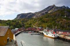 Red Classic Norwegian Rorbu fishing huts, Nusfjord on Lofoten is. Nusfjord, Norway - August 21,2017: Red Classic Norwegian Rorbu fishing huts, Nusfjord on royalty free stock photography