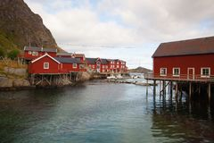 Red Classic Norwegian Rorbu fishing huts, Nusfjord on Lofoten is. Nusfjord, Norway - August 21,2017: Red Classic Norwegian Rorbu fishing huts, Nusfjord on stock images
