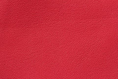 Red classic paint genuine leather background or texture. For background , backdrop, substrate, composition use. With Stock Image
