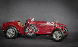 Red classic retro vintage sport car on grey background Royalty Free Stock Photos