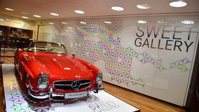 Red classic 300 SL on display at the Mercedes Benz gallery along Champ Elysees in Paris Royalty Free Stock Images