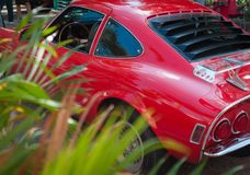 Red Classic Sport Car with grass stock image
