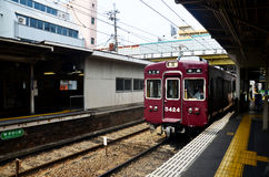 Red classic train of Hankyu kyoto line running from Kyoto statio Stock Image