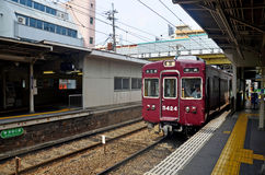 Red classic train of Hankyu kyoto line running from Kyoto statio Stock Images