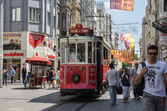 A red classic tram in Istiklal street Stock Photos