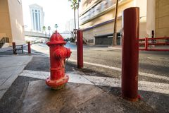 Red classic USA fire hydrant with protection on city street. stock photo