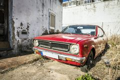 Red, classic,vintage car in a bit abounded place Royalty Free Stock Photos