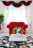 Red classical armchair in living room interior Stock Image