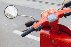 Red classical Italian Piaggio scooter handlebar Stock Photo