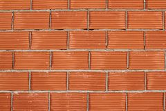 Red clay brick wall construction airbrick Stock Photo
