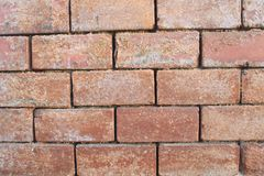Red clay brick wall old eroded stock photos
