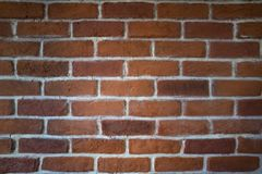 Red clay brick wall. A red clay brick wall with white mortar royalty free stock photography
