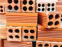 Red clay bricks. A stack of red clay bricks Stock Photos