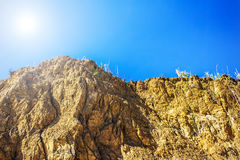 Red clay cliff rock, sky background Stock Images