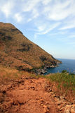 Red clay coastline royalty free stock photos