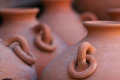 Red clay pottery background. Front view of red clay pottery Royalty Free Stock Photos