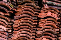Red clay roof tile put in the stack after old tenement renovatio. N, texture, pattern Royalty Free Stock Photography