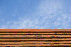 Red clay roof tiles. Red clay roof and blue sky Stock Photos