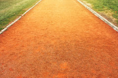 Red clay running track Royalty Free Stock Image