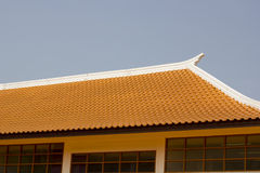 Red clay tiles roof pattern on blue sky Royalty Free Stock Photography