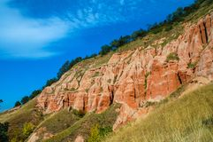 Red clays with dinosaur fossils. Geological reserve. Succession of red and white clays with dinosaur fossils. Geological reserve of Rapa Rosia, Romania Stock Photos