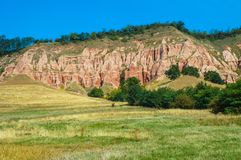 Red clays with dinosaur fossils. Geological reserve. Succession of red and white clays with dinosaur fossils. Geological reserve of Rapa Rosia, Romania Stock Images