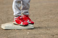Red Cleats on Base Stock Image