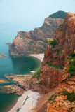 Red Cliff At Sea Shore Stock Photography