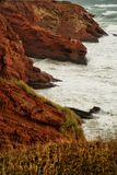 Red cliff in Magdalen islands Royalty Free Stock Images