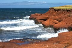 Free Red Cliff In Magdalen Islands Stock Photography - 100651922