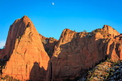 Red cliff and moon in Kolob Canyon, Zion, USA.. Stock Photo