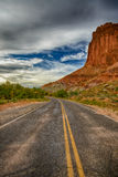 The Red Cliff Over the Highway HDR. Highway 24 going through Capital Reef national Park Utah USA right out of the small town known as Fruita Utah Royalty Free Stock Images