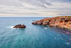 Red Cliffs in Algarve, Portugal. Stock Photos