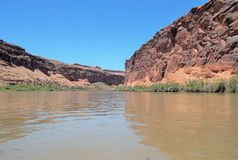 Red Cliffs around the Colorado River. The Colorado River running through the canyon just northeast of Moab, Utah stock photos